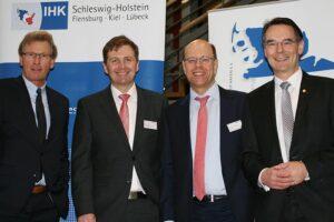 Schleswig-Holsteins Wirtschaftsminister Bernd Buchholz (FDP), Schleswig-Holsteins IHK-Geschäftsführer Björn Ipsen, GvSH-Vorstandsvorsitzender Sebastian Jürgens und Staatssekretär Ingbert Liebing (CDU).